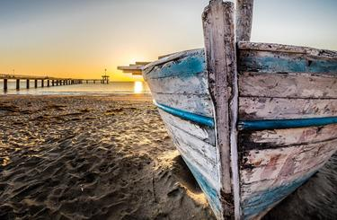 Blog thumb wide old wooden boat at sunrise 2873907 1920
