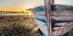 Sidebar thumb big old wooden boat at sunrise 2873907 1920